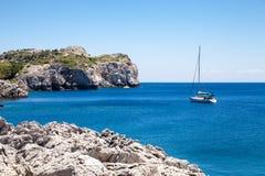 Beach off the coast of the island of Rhodes in Faliraki, Greece. Royalty Free Stock Photos