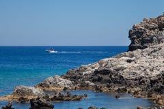 Beach off the coast of the island of Rhodes in Faliraki, Greece. Royalty Free Stock Photo