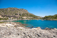 Beach off the coast of the island of Rhodes in Greece. Seaside l Royalty Free Stock Images