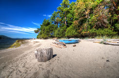 Beach and old boat. Gulf Islands National Park reserve, Cabbage Island, British Columbia, Canada Stock Photography