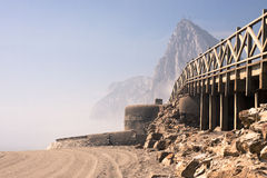 Beach with old bunker and The Rock of Gibraltar Stock Photos