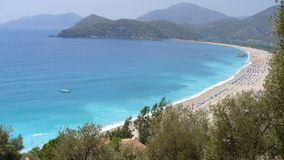 The beach of Oludeniz. On an beautiful day on the beach in oludeniz stock photo