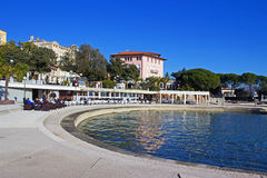 Beach of Opatija Abbazia. Popular summer and winter resort on a sunny winter January day Stock Images