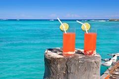 Beach orange cocktail in Caribbean turquoise sea Royalty Free Stock Photos