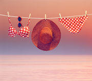 Beach outfit. Summer clothes set on tropical sea Royalty Free Stock Image