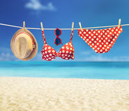 Beach outfit. Summer clothes set on tropical sea. Beach outfit. Summer clothes and accessories stylish set. Fashion swimsuit bikini red polka dots, sunglasses stock image