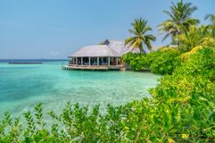 Somewhere in the Maldives. Beach overlooking the houses on the water somewhere in the Maldives stock photo