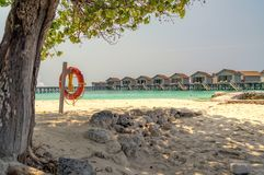 Somewhere in the Maldives. Beach overlooking the houses on the water somewhere in the Maldives royalty free stock images