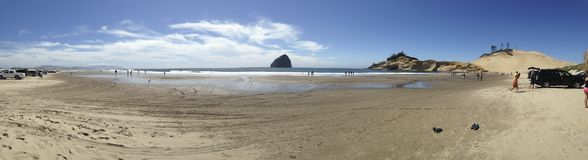 The beach in Pacific City, Oregon. Panorama of the Cape Kiwanda beach in Pacific City, Oregon Stock Photo