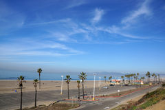 Beach, Pacific ocean, park, parking lot, and restroom buildings Stock Images