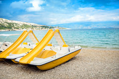 Beach paddle yellow boats, vacation fun details.  Royalty Free Stock Photos