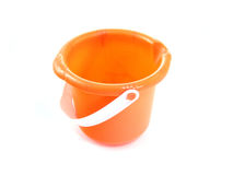 Beach pail. Small orange sand pail isolated on white background Stock Photography