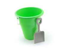 Beach pail and shovel. Green sand pail with shovel isolated on white background Stock Photo