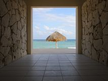 Beach palapa. On the Caribbean coast in Mexico. View through the pass in the hotel Royalty Free Stock Image
