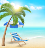 Beach with palm clouds sun umbrella and beach chair. Summer vaca Royalty Free Stock Photography