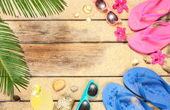 Beach, palm tree leaves, sand, sunglasses and flip flops. Summer holiday (vacation) tropical beach background layout with free text space. Palm tree leaves, sand stock image