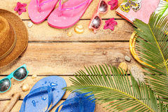 Beach, palm tree leaves, sand, sunglasses and flip. Summer holiday (vacation) tropical beach background layout with free text space. Palm tree leaves, sand stock image