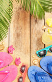 Beach, palm tree leaves, sand, sunglasses and flip Stock Photos