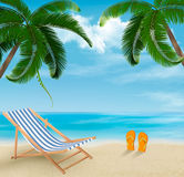 Beach with palm trees and beach chair. Summer vaca Royalty Free Stock Photography