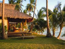 Beach with palm trees and tourist house. Philippines Stock Photos