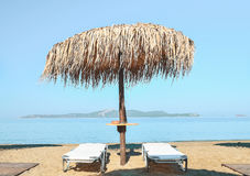 Parasol on the beach. Palm beach umbrella at the beach Stock Photos