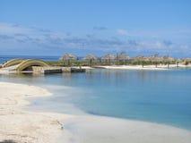 Beach with palm umbrellas in Roatan Honduras royalty free stock photos