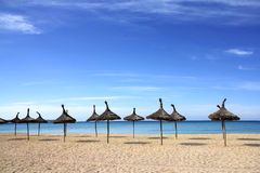 Beach with palm umbrellas. Waiting for the tourist season Royalty Free Stock Images