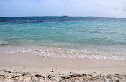 Beach in Palomino. Clear waves roll in to the white sand beach of Palomino in Puerto Rico Stock Photography