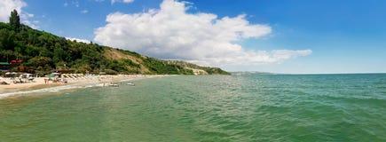 Beach panorama. Summer vacation background at the seashore beach. Panoramic view of the coast of Black Sea, Balchik city, Bulgaria Stock Photos
