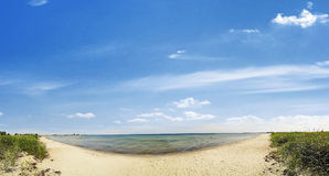 Beach - panorama view - baltic sea. Beach panorama - sand and ocean with blue sky Stock Photos