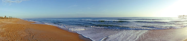 Beach Panoramic View. With Pier and Palms Royalty Free Stock Photo