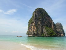 Beach paradise. Isolated island on the shores of thailand with blue sky stock images