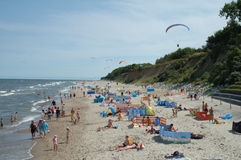Beach and paragliders Stock Photography