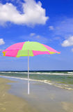 Beach parasol. Over the ocean and blue sky background Royalty Free Stock Photos