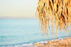 Parasol on the beach. Parasol on the azure coast Stock Image