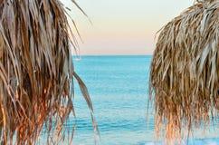 Parasols on the beach. Parasol on the azure coast Stock Photo