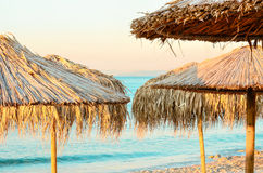 Beach umbrellas. Parasol on the azure coast Stock Image