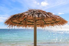 A Beach Parasol. Looking out to the Caribbean Sea with a beach parasol in the foreground Stock Photo