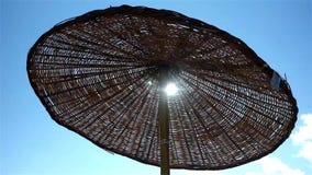 Beach parasol stock video footage