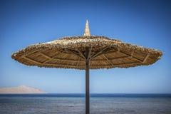 Beach parasol sun shade. Wooden beach parasol beach shade Stock Images