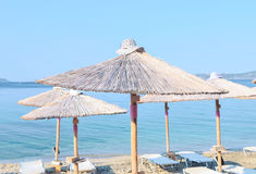 Parasols on the beach. Parasols with beautiful hats on top Royalty Free Stock Photography