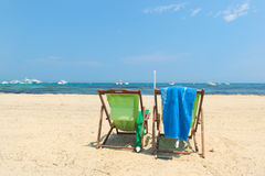 Beach with parasols and beds Royalty Free Stock Image