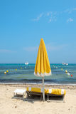 Beach with parasols and beds Stock Photo