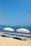 Beach with parasols and beds Royalty Free Stock Photography