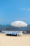 Beach with parasols and beds Royalty Free Stock Images