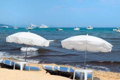 Beach with parasols and beds Stock Image