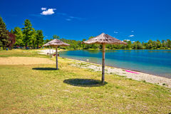 Beach and parasols on Soderica lake Stock Photography