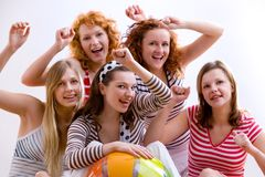 Beach party!. Group of five girls with a beach ball Stock Images