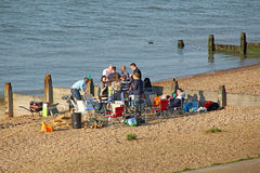 Beach party bbq. Photo of family enjoying party bbq on beach at whitstable in kent taken 29th april 2017 royalty free stock images