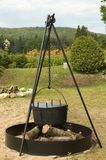 Beach party' cooking pot. Big iron cooking pot ready to cook beans or corns over a campfire on the beach royalty free stock photo